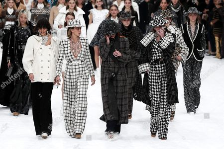 British model Cara Delevingne (2-L), Argentinian model Mica Arganaraz (L), Italian model Mariacarla Boscono (2-R) and crying models pay tribute to late German designer Karl Lagerfeld after the presentation of the Fall/Winter 2019/20 Women's collection of Chanel fashion house during the Paris Fashion Week, in Paris, France, 05 March 2019. Lagerfeld died aged 85 on 19 February 2019. His final collection for Chanel was presented at the Grand Palais on the last day of the Paris Fashion Week.