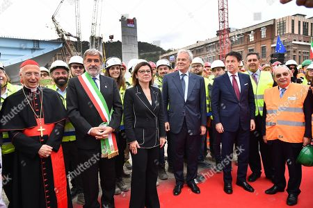 (L-R) Angelo Bagnasco Arcibishop of Genoa, Marco Bucci major of Genoa, Pietro Salini president of Salini Impregilo, Italian Prime Minister Giuseppe Conte, Giuseppe Bono Ceo of Fincantieri, attend the official ceremony for the lifting of the first section of the new Genoa motorway bridge in Genoa, northern Italy, 01 October 2019. The Morandi highway bridge partially collapsed on 14 August 2018, killing 43 people.