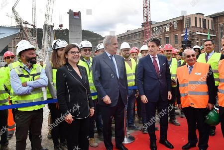 (L-R) Paolo De Michelis Minister of Infrastuctures, Pietro Salini President of Salini Impregilo, Italian Prime Minister Giuseppe Conte, Giuseppe Bono Ceo of Fincantieri, attend the official ceremony for the lifting of the first section of the new Genoa motorway bridge in Genoa, northern Italy, 01 October 2019. The Morandi highway bridge partially collapsed on 14 August 2018, killing 43 people.