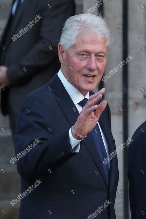 Bill Clinton attends the solemn service at St Saint-Sulpice church