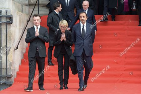 Claude Chirac, daughter of Jacques Chirac, her son Martin Rey Chirac and her husband Frederic Salat-Baroux attend the solemn service at St Saint-Sulpice church