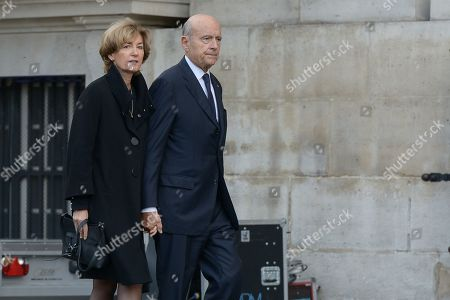 Stock Image of Arrival of Alain Juppe with his wife attend the solemn service at St Saint-Sulpice church