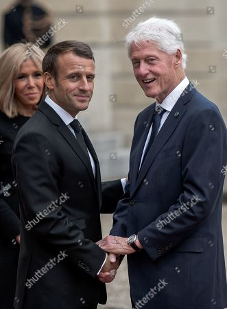 Emmanuel Macron and Bill Clinton attend a reception for foreign dignitaries at the Elysee Palace following the service at Saint-Sulpice church
