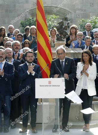 Catalan regional President, Joaquim Torra (C), delivers a speech called 'October Commitment', next to Deputy President, Pere Aragones (3-L), and the rest of the Catalan government's members, at Catalan regional Government Palace's courtyard in Barcelona, Catalonia, Spain, 01 October 2019. Torra announced his 'commitment' to go on 'without excuses' towards the goal of the 'Catalan Republic', as part of events to mark the second anniversary of the unlawful October First independence referendum held in Catalonia in 2017.