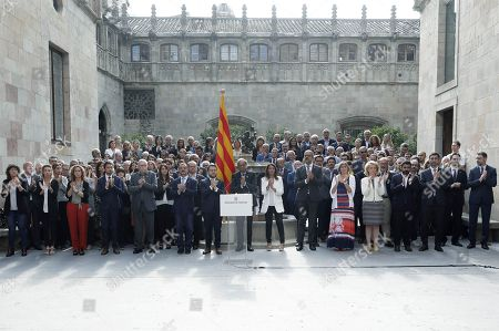 Catalan regional President, Joaquim Torra (C), delivers a speech called 'October Commitment', next to the rest of the Catalan government's members, at Catalan regional Government Palace's courtyard in Barcelona, Catalonia, Spain, 01 October 2019. Torra announced his 'commitment' to go on 'without excuses' towards the goal of the 'Catalan Republic', as part of events to mark the second anniversary of the unlawful October First independence referendum held in Catalonia in 2017.