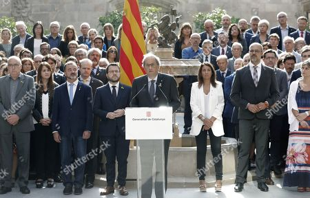 Catalan regional President, Joaquim Torra (C), delivers a speech called 'October Commitment', next to Deputy President, Pere Aragones (5-L), and the rest of the Catalan government's members, at Catalan regional Government Palace's courtyard in Barcelona, Catalonia, Spain, 01 October 2019. Torra announced his 'commitment' to go on 'without excuses' towards the goal of the 'Catalan Republic', as part of events to mark the second anniversary of the unlawful October First independence referendum held in Catalonia in 2017.
