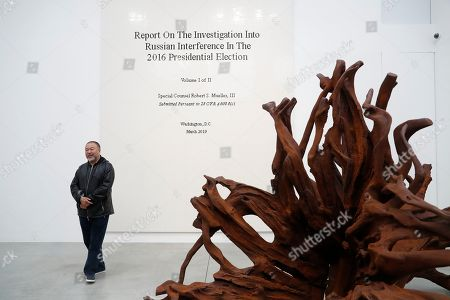 Ai WeiWei. Chinese artist Ai Weiwei poses for the media in front of his work made of Lego bricks of the front page of the Mueller report into Russian inteference in the 2016 US Presidential Election, at an art gallery in London, . The exhibition also features a new series of monumental sculptural work in iron cast from giant tree roots sourced in Brazil