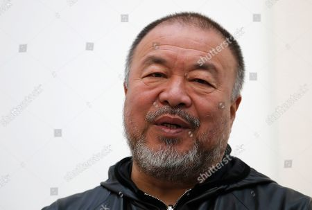 """Ai WeiWei. Chinese artist Ai Weiwei speaks to the media at the opening of his exhibition entitled 'Roots"""" at an art gallery in London, . This exhibition features a new series of monumental sculptural work in iron, cast from giant tree roots sourced in Brazil"""