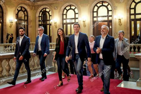 Ciudadanos (Citizens) party's leader Albert Rivera (4-L), the party's Spokeswoman, Lorena Roldan (3-L), and Ciudadanos' leader at Catalan Parliament, Carlos Carrizosa (2-R), arrive at Catalan regional Parliament to attend a meeting of the party's regional parliamentary group in Barcelona, Spain, 01 October 2019. The meeting is held a day after Ciudadanos filed a non-confidence motion against Catalan regional President Joaquim Torra (unseen).