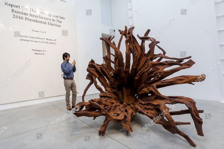 A man looks at Chinese artist Ai Weiwei's 'Martin 2019' roots sculpture during a press preview at the Lisson Gallery, in London, Britain, 01 October 2019. The exhibition runs from 02 October to 02 November 2019 and features a new series of monumental sculptural work in iron cast from giant tree roots sourced in Brazil.