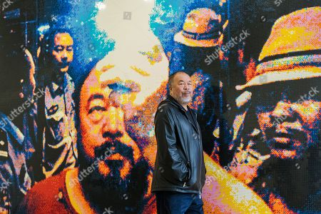 Chinese artist Ai Weiwei poses in front of his artwork 'Illumination 2019' made from Lego during a press preview at the Lisson Gallery, in London, Britain, 01 October 2019. The exhibition runs from 02 October to 02 November 2019 and features a new series of monumental sculptural work in iron cast from giant tree roots sourced in Brazil.