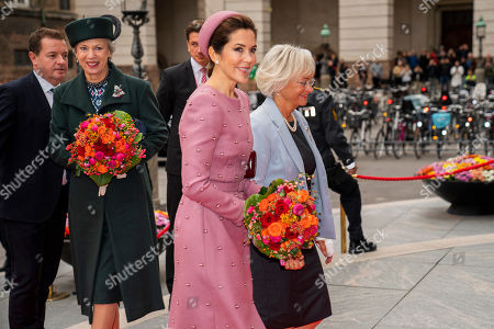 Stock Photo of Denmark's Crown Princess Mary (C) and Princess Benedikte (2-L) arrive for the opening of the Danish Parliament at Christiansborg Palace in Copenhagen, 01 October 2019. Others are not identified.