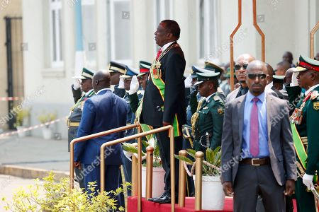 Zimbabwen President Emmerson Mnangagwa (C) inspects a guard of honour outside the House of Parliament in Harare, Zimbabwe, 01 October 2019. Mnangagwa has officially opened the second session of the Ninth Parliament of Zimbabwe and addressed parliamentarians on the state of the nation.
