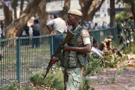 An armed soldier stands guard outside the House of Parliament in Harare, Zimbabwe, 01 October 2019. Zimbabwean President Mnangagwa has officially opened the second session of the Ninth Parliament of Zimbabwe and addressed parliamentarians on the state of the nation.