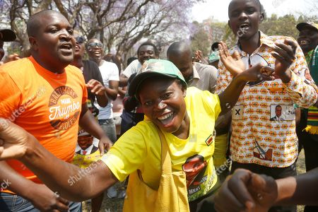 Zimbabwe African National Union Patriotic Front  (Zanu PF) supporters sing and dance outside the House of Parliament in Harare, Zimbabwe, 01 October 2019. Zimbabwean President Mnangagwa has officially opened the second session of the Ninth Parliament of Zimbabwe and addressed parliamentarians on the state of the nation.