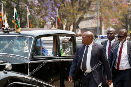 Stock Picture of Zimbabwean President Emmerson Mnangagwa (C) rides in a Rolls Royce vehicle as he departs the House of Parliament in Harare, Zimbabwe, 01 October 2019. Mnangagwa has officially opened the second session of the Ninth Parliament of Zimbabwe and addressed parliamentarians on the state of the nation.