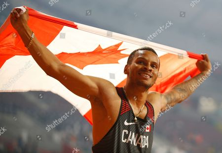 Silver medalist Andre de Grasse of Canada celebrates after the men's 200m final at the IAAF World Athletics Championships 2019 at the Khalifa Stadium in Doha, Qatar, 01 October 2019.