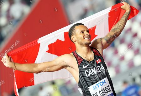 Andre De Grasse of Canada celebrates after taking the second place in the men's 200m final at the IAAF World Athletics Championships 2019 at the Khalifa Stadium in Doha, Qatar, 01 October 2019.