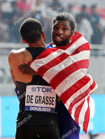Noah Lyles (R) of the USA is congratulated by second placed Andre De Grasse (L) of Canada after winning the men's 200m final at the IAAF World Athletics Championships 2019 at the Khalifa Stadium in Doha, Qatar, 01 October 2019.