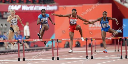 Athletes from left, Hanne Claes, of Belgium, Ashley Spencer, of the United States, Aminat Jamal, of Bahrain, and Ayomide Folorunso, of Italy, compete in a women's 400 meter hurdle heat at the World Athletics Championships in Doha, Qatar