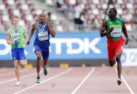 Kirani James, of Grenada, right, looks across at Vernon Norwood, of the United States in a men's 400 meter heat at the World Athletics Championships in Doha, Qatar