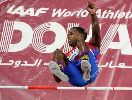 Luis Enrique Zayas, of Cuba, clears the bar during men's high jump qualifying at the World Athletics Championships in Doha, Qatar