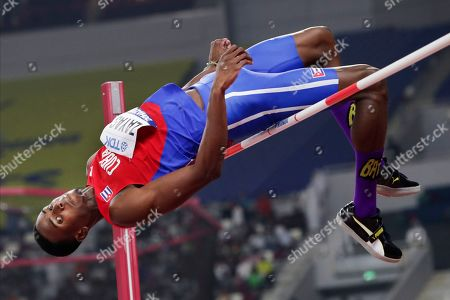 Luis Enrique Zayas, of Cuba, competes in the men's high jump qualifications at the World Athletics Championships in Doha, Qatar