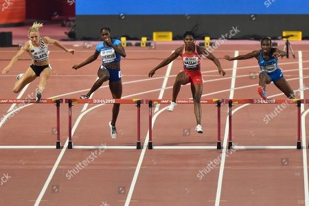 Hanne Claes, of Belgium, Ashley Spencer, of the United States, Aminat Jamal, of Bahrain, and Ayomide Folorunso, of Italy, from left, compete in the women's 400 meter hurdle heats at the World Athletics Championships in Doha, Qatar