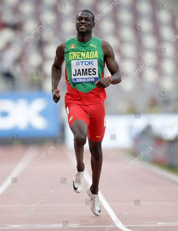 Stock Photo of Kirani James, of Grenada, crosses the finish line in a men's 400 meter heat at the World Athletics Championships in Doha, Qatar
