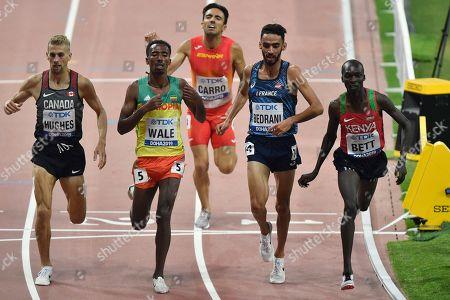 Matthew Hughes, of Canada, Getnet Wale, of Ethiopia, Fernando Carro, of Spain, Djilali Bedrani, of France, and Leonard Kipkemoi Bett, of Kenya, from left, cross the finish line in the men's 3000 meter steeplechase heats at the World Athletics Championships in Doha, Qatar