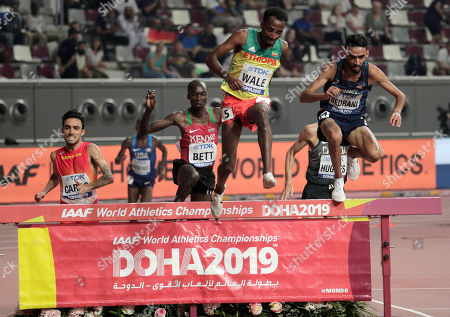 Djilali Bedrani, of France, right, and Getnet Wale, of Ethiopia, second right, clear the water jump in the men's 3000 meter steeplechase heats at the World Athletics Championships in Doha, Qatar