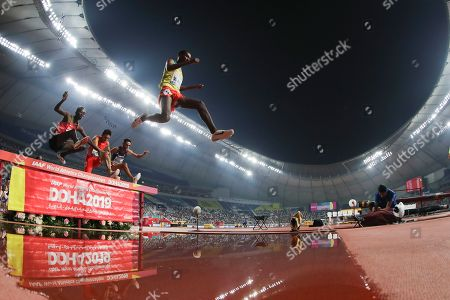 Getnet Wale, of Ethiopia, competes in a men's 3000 meter steeplechase heat at the World Athletics Championships in Doha, Qatar