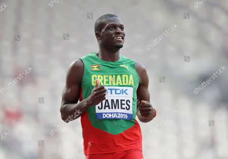 Stock Picture of Kirani James, of Grenada gestures after finishing a men's 400 meter heat at the World Athletics Championships in Doha, Qatar