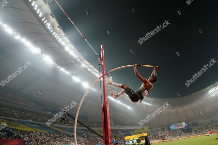 Stock Photo of Raphael Holzdeppe, of Germany, competes the men's pole vault final at the World Athletics Championships in Doha, Qatar