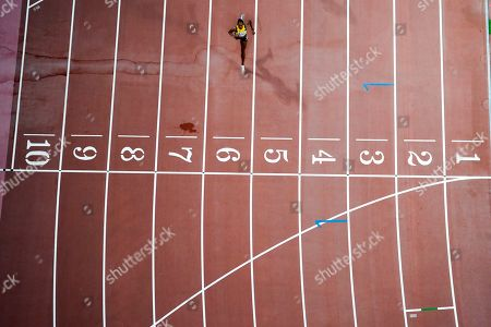 Stephenie Ann Mcpherson, of Jamaica, heads to the finish line during her heat in the women's 400 meter semi finals at the World Athletics Championships in Doha, Qatar