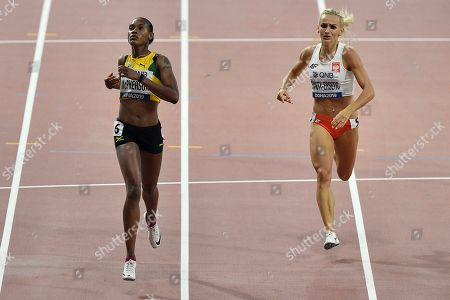 Stephenie Ann Mcpherson, of Jamaica, left, and Justyna Swiety-Ersetic, of Poland, compete in the women's 400 meter semifinals at the World Athletics Championships in Doha, Qatar