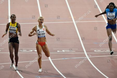 Kendall Ellis, of the United States, right, finishes after Justyna Swiety-Ersetic, of Poland, second left, and Stephenie Ann Mcpherson, of Jamaica, left, in the women's 400 meter semifinals at the World Athletics Championships in Doha, Qatar