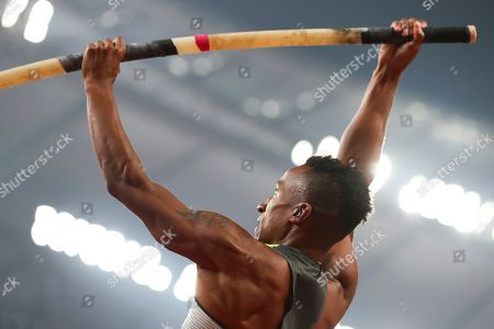 Raphael Holzdeppe, of Germany, competes in the men's pole vault final at the World Athletics Championships in Doha, Qatar