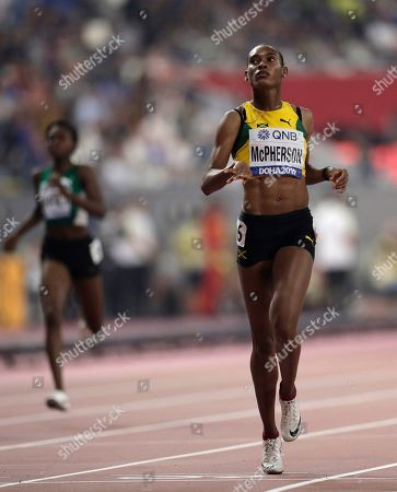 Stephenie Ann Mcpherson, of Jamaica, races in a women's 400 meter semifinals at the World Athletics Championships in Doha, Qatar