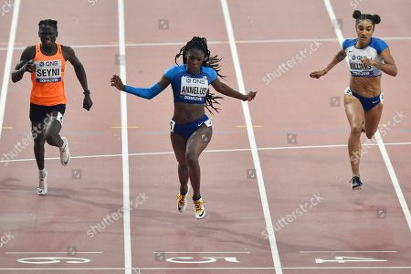 Anglerne Annelus, of the United States, finishes ahead of Aminatou Seyni, of Niger, left, and Jodie Williams, of Great Britain, during the women's 200 meter semifinals at the World Athletics Championships in Doha, Qatar