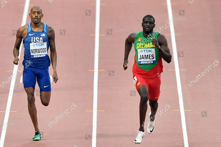 Stock Image of Vernon Norwood, of the United States, front, and Kirani James, of Grenada, right, compete in the men's 400 meter heats at the World Athletics Championships in Doha, Qatar