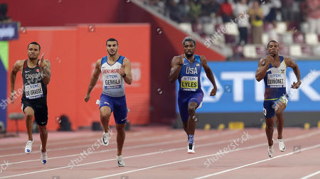 Noah Lyles of the U.S., second right, races to win the gold in the men's 200 meter final ahead of Andre de Grasse of Canada, left, silver, and Alex Quinonez of Ecuador, second right, bronze, and Adam Gemili of Great Britain, fourth, at the World Athletics Championships in Doha, Qatar