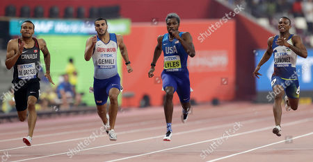Noah Lyles of the U.S., second right, races to win the gold medal in the men's 200 meter final ahead of Andre de Grasse of Canada, left, silver, and Alex Quinonez of Ecuador, right, bronze, and Adam Gemili of Great Britain, fourth, at the World Athletics Championships in Doha, Qatar