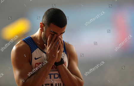 Adam Gemili of Great Britain reacts after finishing fourth in the men's 200 meter final at the World Athletics Championships in Doha, Qatar
