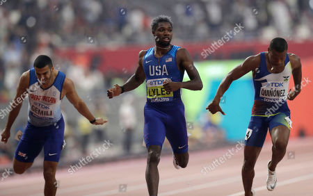 Noah Lyles of the U.S., center, races to win the gold medal in the men's 200 meter final ahead of Alex Quinonez of Ecuador, right, bronze, and Adam Gemili of Great Britain, fourth, at the World Athletics Championships in Doha, Qatar