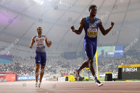 Noah Lyles of the U.S., right, races to win the gold medal in the men's 200 meter final ahead of Adam Gemili of Great Britain, fourth, at the World Athletics Championships in Doha, Qatar