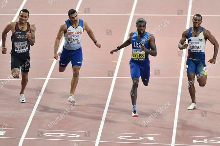 Noah Lyles of the U.S., second right, on his way to win the gold medal in the men's 200 meter final ahead of Andre de Grasse of Canada, left, Adam Gemili of Great Britain, second left, and Alex Quinonez of Ecuador, right, at the World Athletics Championships in Doha, Qatar