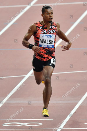 Julian Jrummi Walsh, of Japan, competes in the men's 400 meter heats at the World Athletics Championships in Doha, Qatar