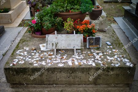 Stock Image of Subway tickets are left on the grave of French musician Serge Gainsbourg, in honor of his first hit song in 1959 'Le Poinconneur Des Lilas, (about a metro attendant), at the Montparnasse cemetery in Paris, France, 01 October 2019. French former president Jacques Chirac who died on 26 September 2019, is buried at the Montparnasse cemetery.