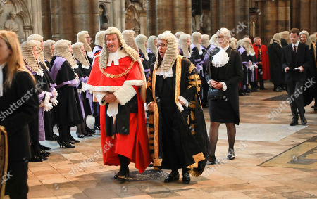 The Right Honourable The Lord Burnett of Maldon, Lord Chief Justice of England and Wales,(Red and White) and  The Right Honourable Robert Buckland QC MP, Lord Chancellor and Secretary of State for Justice,(Gold and Black) process through the Abbey.